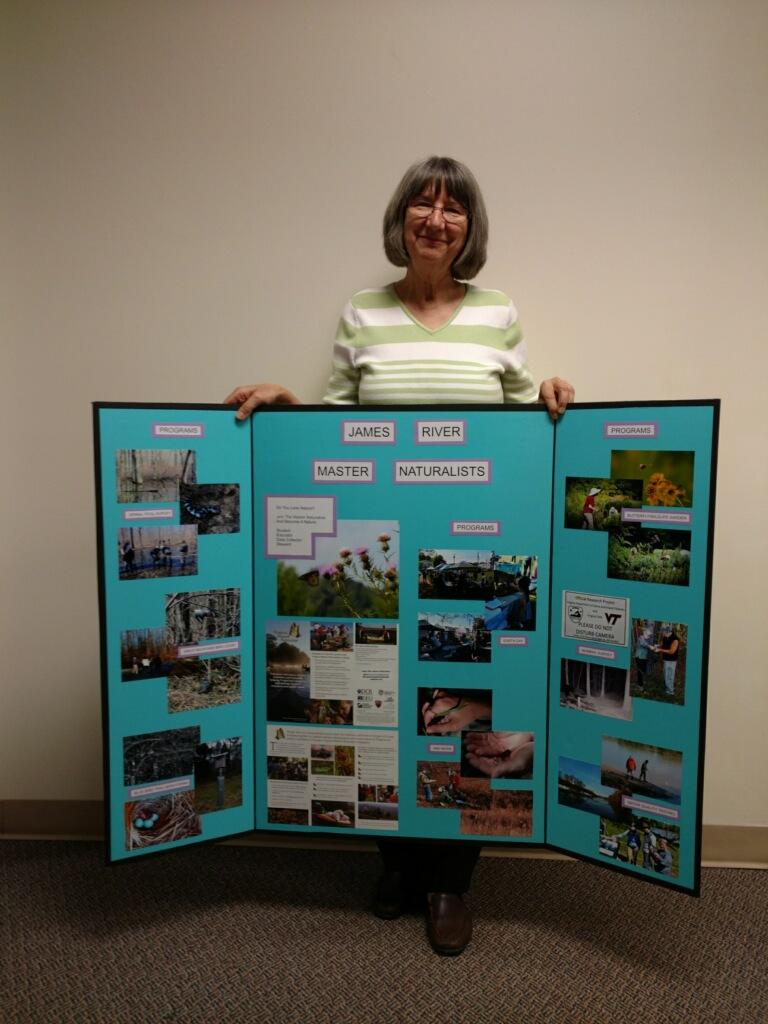 Judy Wyatt with JRMN Poster